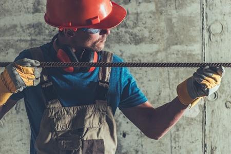 Reinforcement Steel in Construction Worker Hands. Industrial Theme.