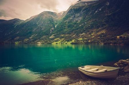 Scenic Norwegian Fjord Landscape with Boat. Reklamní fotografie