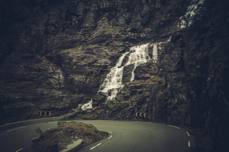 Scenic Mountain Road in the Norway. Raw Norwegian Route with Waterfall.