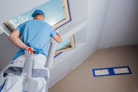 Caucasian Men Painting His Apartment. Construction Theme.