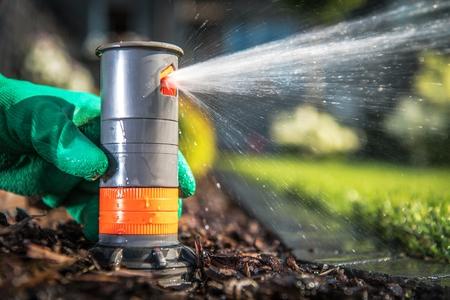 Building and Adjusting Underground Sprinkler System. Closeup Photo. Garden Systems.