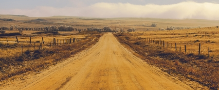 Foggy Countryside Gravel Road in Central Colorado, United States of America. Panoramic Photo. Reklamní fotografie