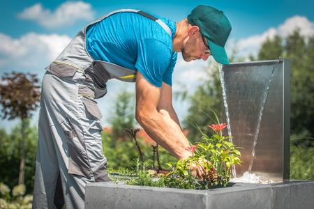 Caucasian Gardener Building Creative Garden.