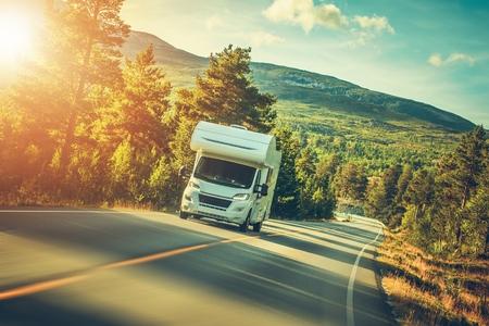 Camper Van Summer Trip. Scenic Norway Landscape and the Recreational Vehicle. Foto de archivo
