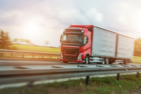 Speeding Red Euro Truck on the Highway.