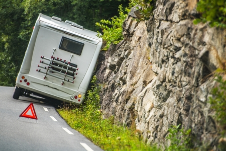 RV Camper Van Accident on the Winding Mountain Road. Stockfoto