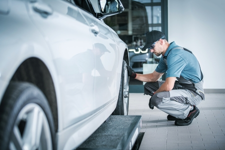 Scheduled Car Service During Vehicle Factory Warranty. Automotive Theme. Caucasian Technician Looking For Potential Issues. Stock fotó