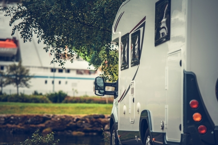Modern Camper Van on the Campsite. Motorhome Vacation Time. Stock Photo