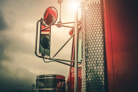 Semi Truck Driving Theme. Outside Mirrors Closeup. Transportation Industry.