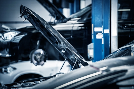 Cars Repairing in Auto Service Center. Modern Vehicles on Lifts. Automotive Industry Theme. Reklamní fotografie