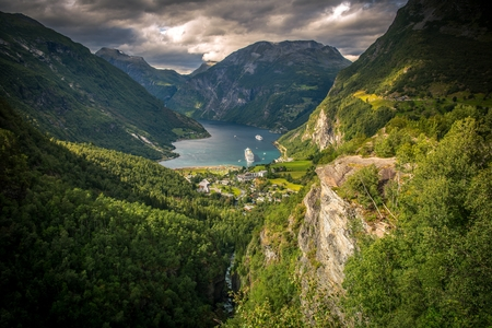 Famous Gejrangerfjord and the Village of Geiranger, Norway.