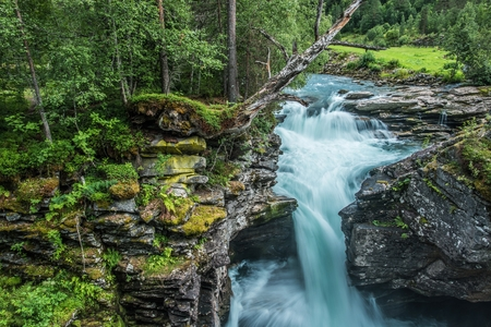 Scenic Waterfall Place. Rocky Norwegian Landscape. Glacial Mountain River.