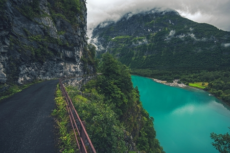 Glacial Lake in Norway. Mountain Winding Cliff Road and the Scenic Vista.