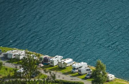 Scenic Waterfront RV Park. Recreational Vehicles Summer Camping. Reklamní fotografie