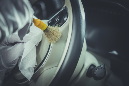 Detailed Car Steering Wheel Cleaning. Professional Vehicle Cleaning Service Concept.