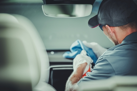 Modern Car Interior Cleaning and Detailing by Professional Caucasian Cleaner. Reklamní fotografie