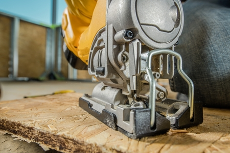 Jig Saw Woodwork Closeup. Plywood Cutting By Contractor Worker. Reklamní fotografie