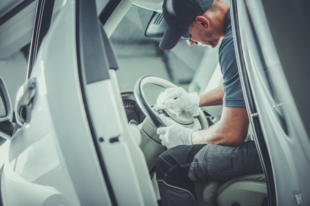 Car Detailing Cleaner. Caucasian Automotive Dealer Worker in His 30s Preparing Vehicle For Sale. Detailed Vehicle Interior Cleaning. Reklamní fotografie