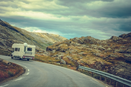 Camper on the Scenic Route. Rocky Scandinavian Landscape Scenery. Recreational Vehicle Road Trip.