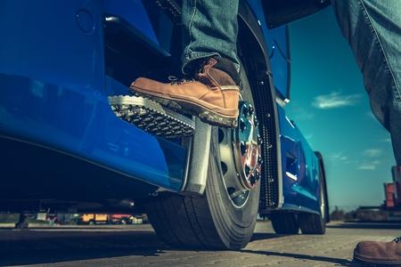 Truck Driver Concept. Driver Getting Into the Semi. Legs Closeup.