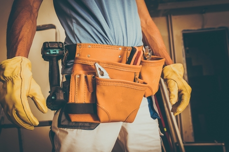 Construction Worker Job. Caucasian Men with Leather Tools Belt Preparing For the Work.