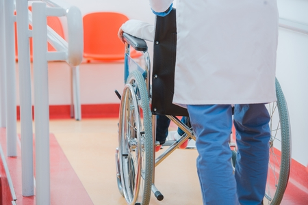 Child on the Wheelchair in the Hospital Hall. Healthcare Theme. Reklamní fotografie