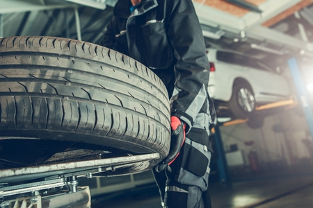 Vulcanizer Tire Replacement. Vehicle in the Auto Service Center. Reklamní fotografie
