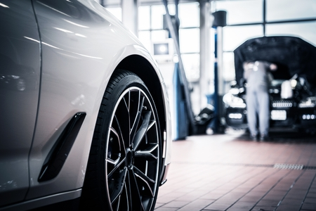 Auto Service and Vehicle Maintenance by Professional Technician in the Background. Automotive Industry. Reklamní fotografie
