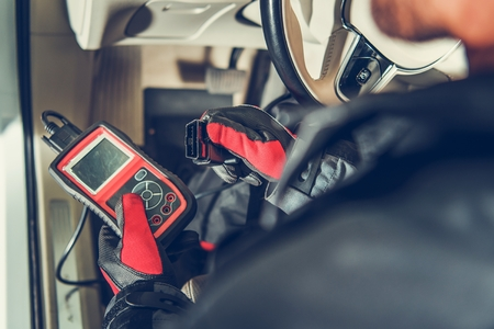 Auto Service Diagnostic Tool in Hands of Vehicle Maintenance Worker. Car Computer Error Reading Using Mobile Device. Reklamní fotografie