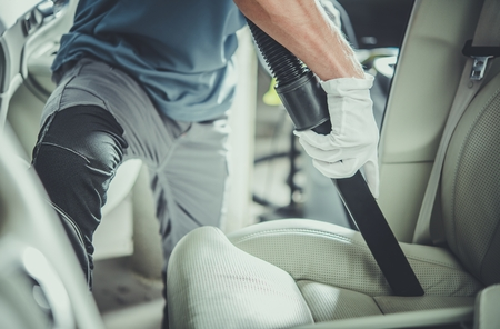 Vehicle Interior Vacuuming by Professional Caucasian Cleaner. Keeping Car Clean Inside. Reklamní fotografie