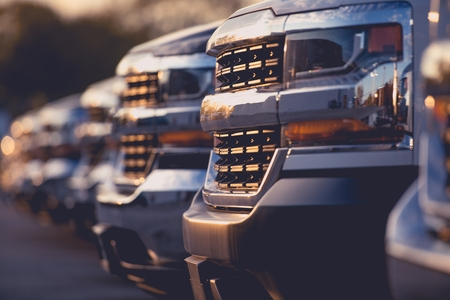Trucks Dealer Vehicles Stock Row. Selective Focus. Automotive Dealership.