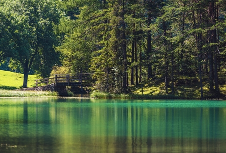 Scenic Turquoise Lake with Wooden Bridge in Sunny Summer Day. Bavaria, Germany. Reklamní fotografie