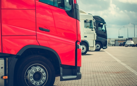 Semi Trucks Parking. Truck Stop Automotive Industry Theme.