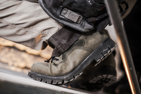 Right Safe Shoes For the Construction Job. Closeup Photo.