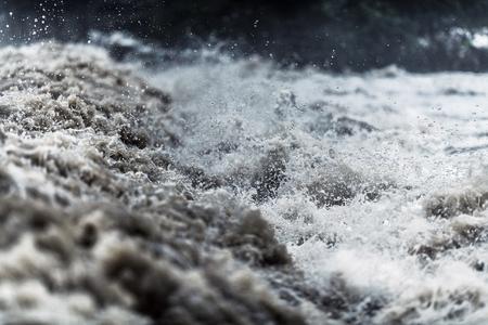 Rushing Flash Flood Water Closeup Photo. Flood Disaster. Stock fotó
