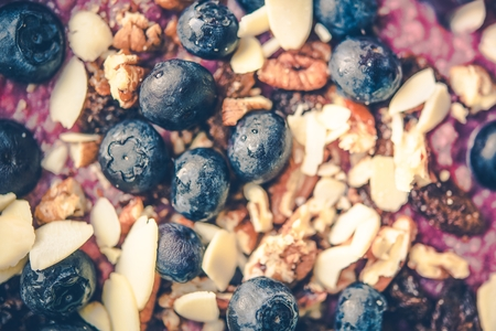 Milk, Nuts and Berries Healthy Diet Breakfast Closeup.