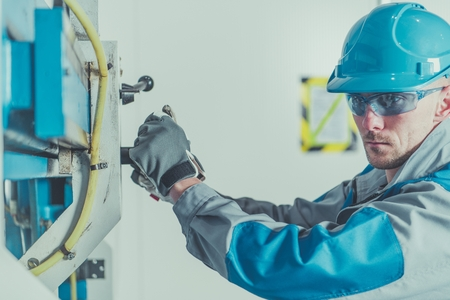 Caucasian Metal Cutting Machine Operator in His 30s. Industrial Theme.
