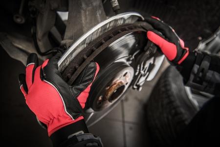 Replacing Car Brake Disc by Auto Service Mechanic. Stok Fotoğraf