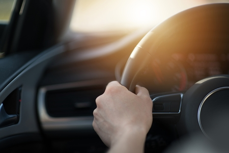 Hand on a Car Steering Wheel. Modern Vehicle Driving Concept. Automotive Industry.