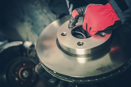 Brand New Brake Disc. Modern Car Brakes Replacement in Auto Service.