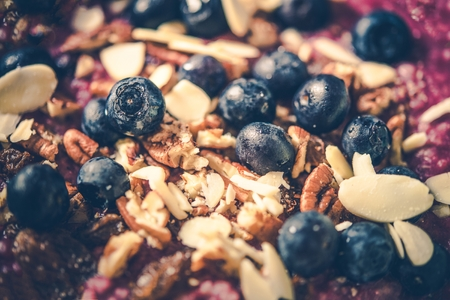 Blueberries and Nuts Health Breakfast Oatmeal Closeup.