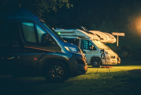 Travel Industry. Modern Camper Vans in the RV Park During Night Hours. Rving Theme. Stock Photo - 118061744
