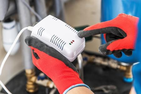Having Carbon Monoxide and Nature Gas Detector Inside a House. Safety Device. Reklamní fotografie - 119984023