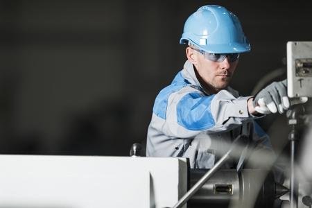 Caucasian Metalworking Technician Worker in His 30s. Metal Industry.