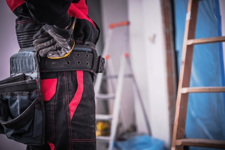 Small Remodeling Job. Construction Worker Closeup Photo.