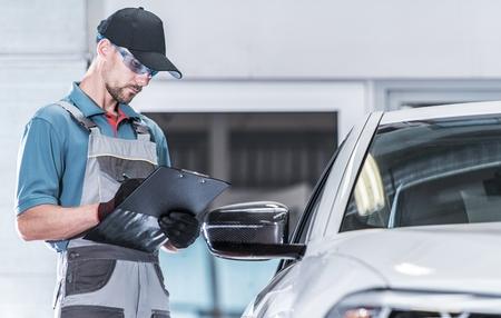 Certified Auto Service Worker Making Warranty Documentation. Vehicle Under Maintenance. Automotive Concept. Reklamní fotografie