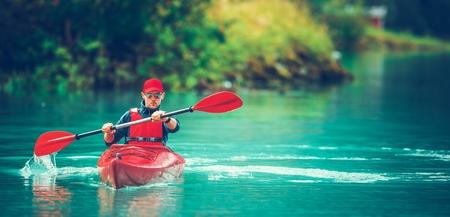Recreational Kayak Tour. Caucasian Men in a Kayak on Glacial Lake.