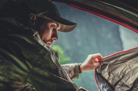 Caucasian Hunter in His 30s in a Tent. Hunting Season.