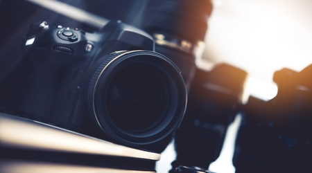 Photography Industry Equipment. Modern Digital Photo Camera and Lenses.