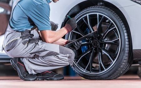 Tires and Wheels Inspection by Professional Automotive Technician in the Certified Auto Service. Reklamní fotografie